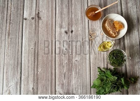 Natural Home Skin Care. Preparing A Face Mask. Leaves And Decoction Of Nettle Dioecious, Honey And O
