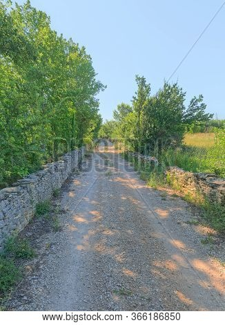 Traditional Drywall In Perspective As A Fence Of Dirt Road In Promina County In Croatia. Croatian Dr