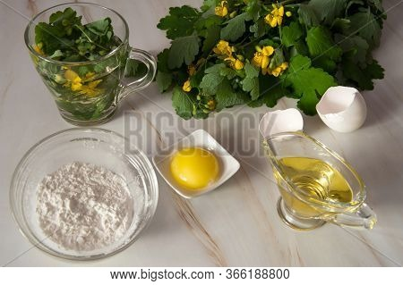 Natural Home Skin Care. Ingredients Of A Face Mask. Celandine Decoction, Olive Oil, Starch And Egg Y