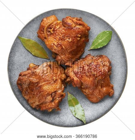 Filipino Chicken Adobo On Gray Plate Isolated On White Backdrop. Chicken Adobo Is Filipino Cuisine D