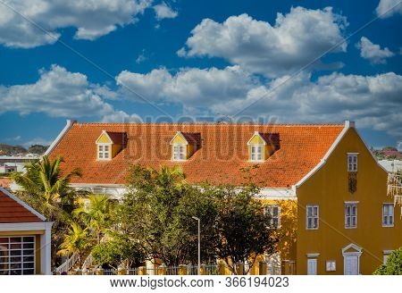 Red Tile Roof On Bonaire Government Building Under Blue Sky