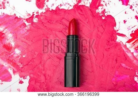 Red Lipstick On Abstract Make-up Background. Flat Lay