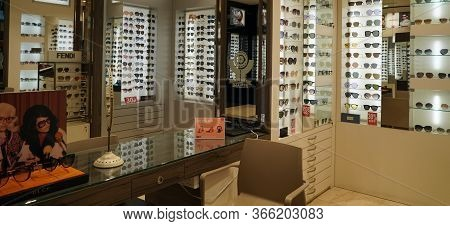 Dubai Uae December 2019 Sunglasses In A Store. Sales Rack Of Sunglasses. Prada, Dior, Roberto Cavall