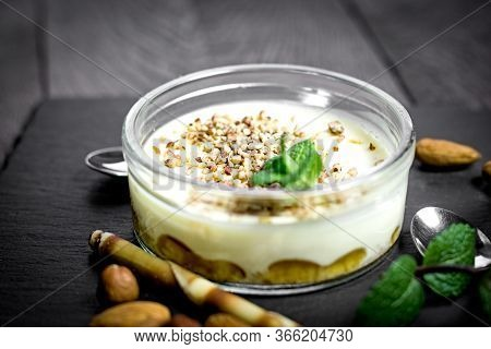 Cheesecake In Glass Bowl On, Creamy Cheesecake With Nuts On Rustic Wooden Table