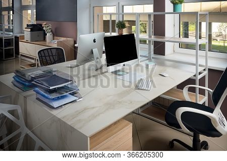 Grodno, Belarus - May 2020: Two Apple Imac In Office Table With Stoneware Table Top, Modern Workplac