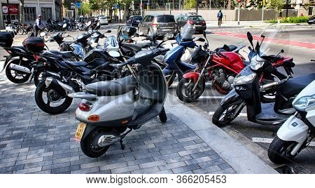 Barcelona, Catalonia, Spain - April 17, 2015: scooter motorcycle (motorbike) rentals in the street.