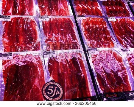 Barcelona, Catalonia, Spain - April 15, 2015: Famous Iberico meat products produced from black Iberian pigs in La Boqueria Market next to La Rambla.