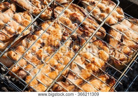 A Close-up Of Browned Red Fish Steaks Grilled On A Grill Over An Open Fire - A Mouth-watering Health