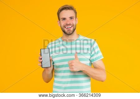 Best Phone Weve Tested. Happy Man Give Thumbs Up To Phone. Handsome Guy Hold Cell Phone. Modern Life