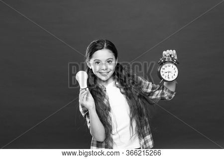 Little Girl Hold Light Bulb. Cute Child Search For Inspiration. Time Of Lighting. Idea And Inspirati