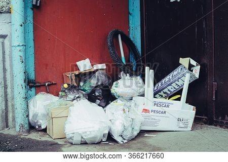 Garbage Piled Near Entrance To Urban Apartment Building. Trash Heap Blocked Garbage Chute. Bunch Of