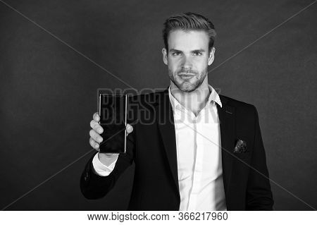 Phone Keeps Him Organized. Businessman Show Mobile Phone. Handsome Man With Cell Phone. Phone For Pe