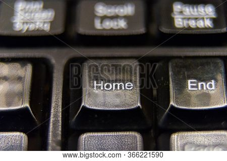 Black Plastic Keyboard. After Extreme Use Home Button Close-up Macro View.