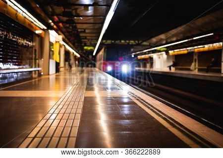 Train Arriving At An Empty Subway Train Station Blurred