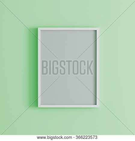 Blank Frame On Light Green Wall Mock Up, Vertical Black Poster Frame On Wall,  Picture Frame Isolate
