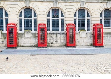 Row Of Beautiful Old Fashioned British Red Telephone Boxes