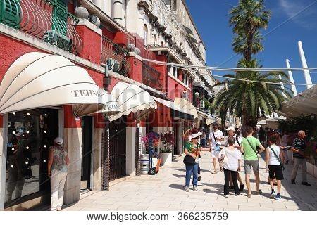 Split, Croatia - July 20, 2019: Tourists Visit Palm Tree Boulevard Of Split. Croatia Had 18.4 Millio