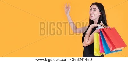 Shopping Woman Holding Shopping Bags On Yellow Background At Copy Space. Cheerful Happy Woman Enjoyi