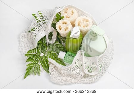 Different Containers For Lotion, Shampoo, Conditioner Or Liquid Soap In Eco Bag. Loofah Or Luffa Was