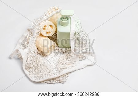 Green Container For Shampoo, Conditioner Or Liquid Soap In Eco Bag. Loofah Or Luffa Washcloth, Veget