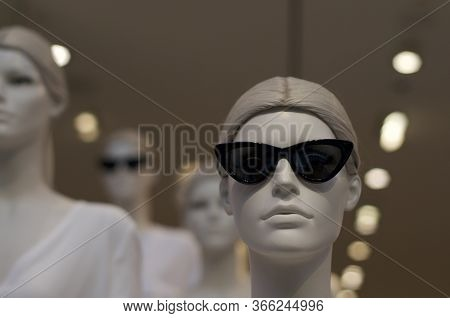 Close Up Of A Cool Female Mannequin With Sunglasses And With Others Mannequin In Background. This Ca