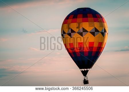 Hot Air Balloon Floating By During A Beautiful Sunset During An Airshow