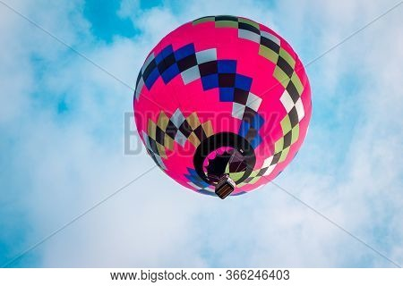 Pink Hot Air Balloon Floating Overhead At An Airshow