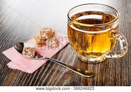 Rakhat-lukum, Teaspoon On Pink Paper Napkin, Transparent Cup With Tea On Dark Wooden Table