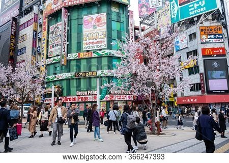 Tokyo, Japan - March 22, 2019: View Of People Walking Through Entertainment, Business And Shopping A