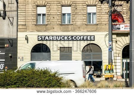 Budapest, Hungary - October  11, 2019: View Of Starbucks Front Store, An American Coffee Company And