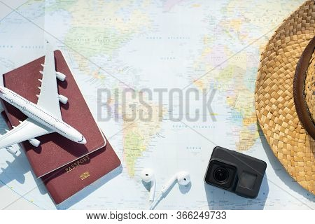 Passport With A Map Background.travel Planning.top View Of Traveler Accessories With A Plane, Camera