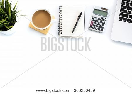 Flat Lay, Top View Office Table Desk. Workspace With Calculator,pen,laptop,note,coffee On White Back