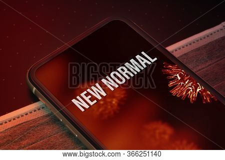 New Normal After Covid 19 Outbreak Background Concept. The New Normal Message On The Smartphone With