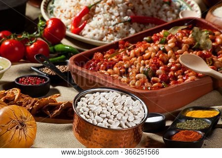 Cooked And Uncooked Haricot Beans, Served With Traditional Cooked Rice And Table Garnished With Seve