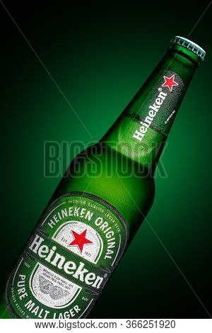 Minsk, Belarus - May 10, 2020 : Bottle Of Heineken Lager Beer On Green Background