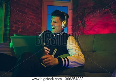 Laughting. Cinematic Portrait Of Stylish Man In Neon Lighted Interior. Toned Like Cinema Effects, Br