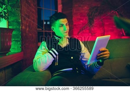 Interested. Cinematic Portrait Of Stylish Man In Neon Lighted Interior. Toned Like Cinema Effects, B