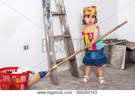 young girl clean the room during repairs