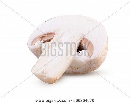 Half Of Fresh Champignon Mushroom Isolated On White Background. Close Up Of Sliced Champignon Fresh,