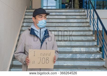 Need A Job, Asian Unemployed Adult Male In A Mask With Poster. Unemployment, Loss Job From Coronavir