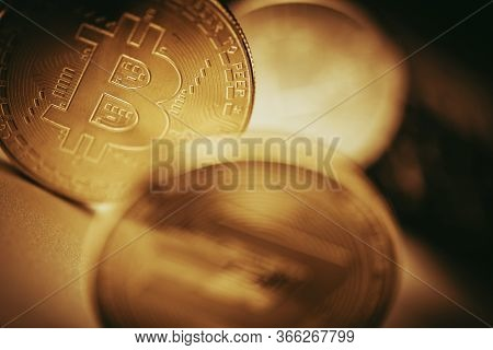 Close Up Of Golden Bitcoin Virtual Currency Coinage Set On Table.