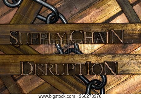 Photo Of Real Authentic Typeset Letters Forming Supply Chain Disruption Text With Steel Chain On Vin