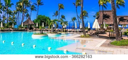 Tropical holidays. Sofitel Mauritius L'Impérial Resort & Spa - Luxury hotel in Mauritius island, Flic en Flac beach. 05.02.2020