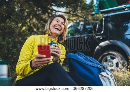 Girl Smile Showing Teeth Calling On Mobile Phone Summer Forest. Happy Tourist With Backpack Cellphon