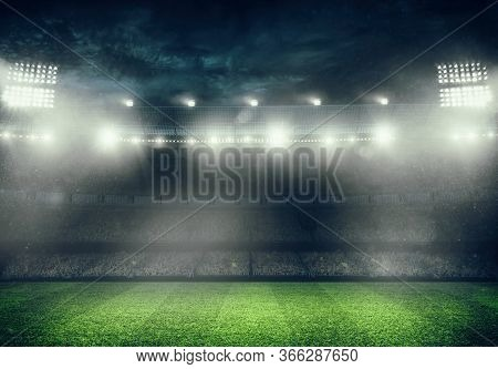 Football Stadium With The Stands Full Of Fans Waiting For The Night Game. 3d Rendering