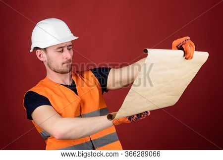 Foreman Concept. Engineer, Architect, Builder On Strict Face Holds Blueprint In Hands, Supervises Co
