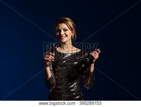 Lady In Shining Dress With Smiling Face Drinks Cabernet
