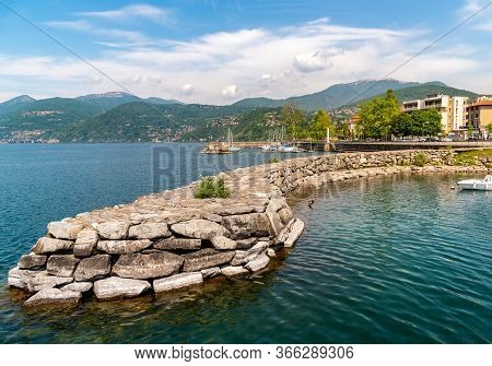 Pier Of The Small Tourist Town Luino On The Shore Of Lake Maggiore In Province Of Varese, Italy