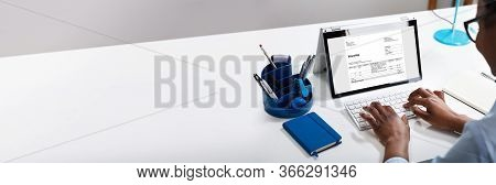 Business E Invoice On Laptop. Digital And Electronic Invoices