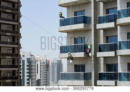 Three High-rise Workers Wash Windows Of A High-rise Building In Dubai. 11-04-2018